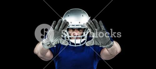 Composite image of portrait american football player defending