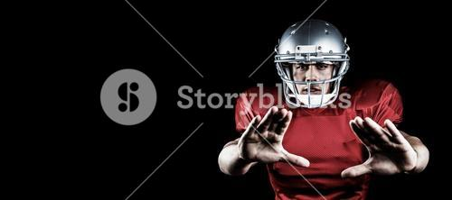 Composite image of portrait of american football player defending