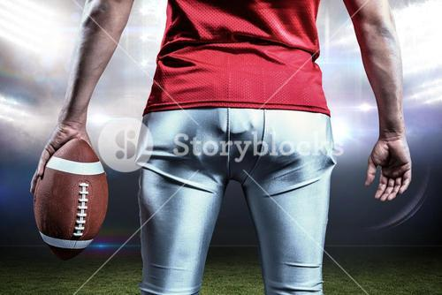 Composite image of mid section of sportsman with american football