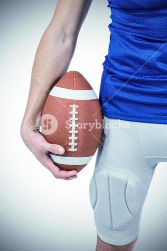 Sports player holding ball