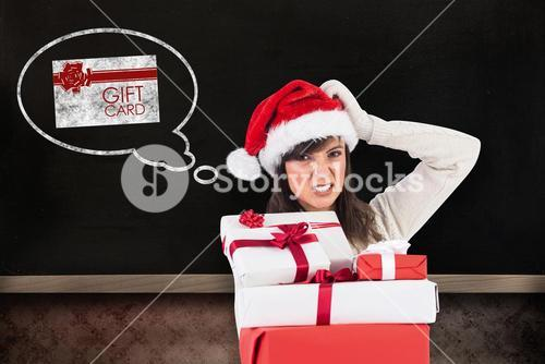 Composite image of attractive santa woman scratching head and holding gifts