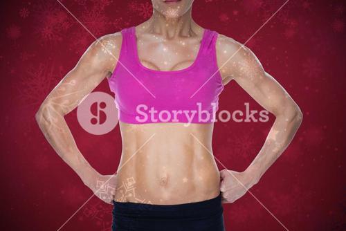 Composite image of female bodybuilder posing in pink sports bra and shorts mid section