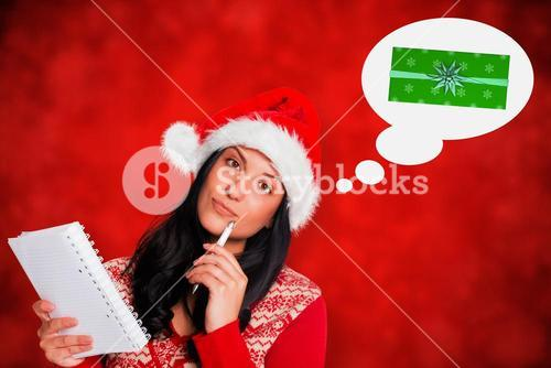 Composite image of woman thinking what to write