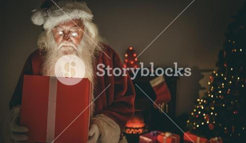 Santa claus delivering a glowing gift