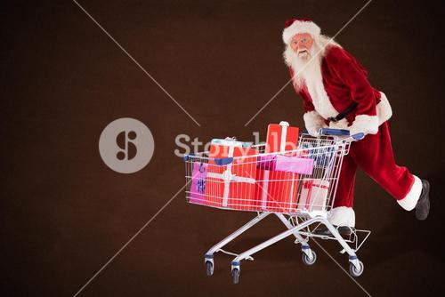 Composite image of santa rides on a shopping cart