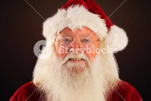 Composite image of santa smiles in the camera