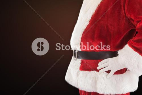 Composite image of santa claus belly from the side