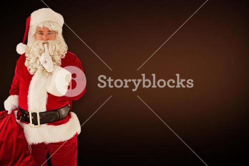Composite image of santa holding his sack and keeping a secret