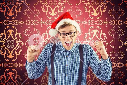 Composite image of geeky hipster wearing santa hat