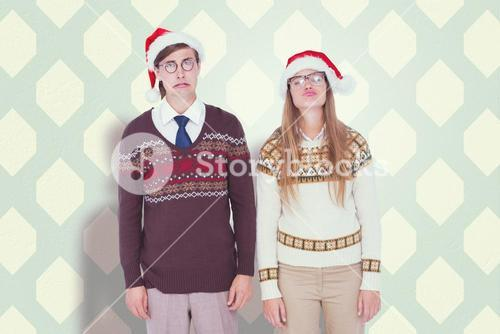 Composite image of sad geeky hipster couple