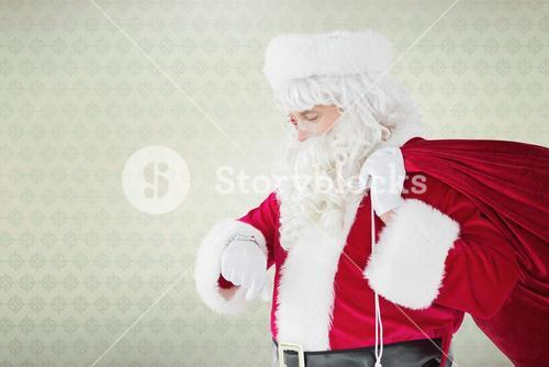 Composite image of festive santa claus checking time