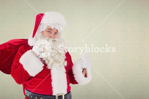 Composite image of santa claus with his sack and thumbs up