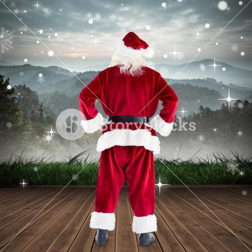 Composite image of santa standing with hands on hips