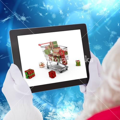 Composite image of santa claus using tablet pc