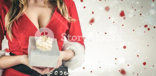 Composite image of sexy santa girl holding gift