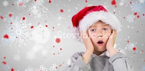 Composite image of festive surprised boy