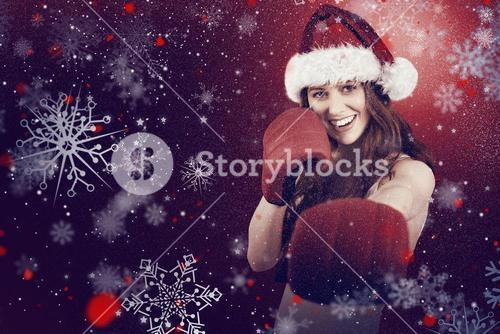 Composite image of festive redhead punching with boxing gloves