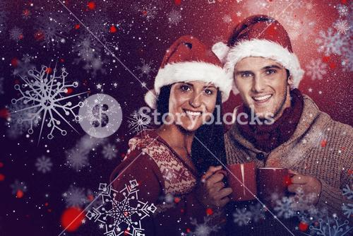 Composite image of young festive couple holding mugs