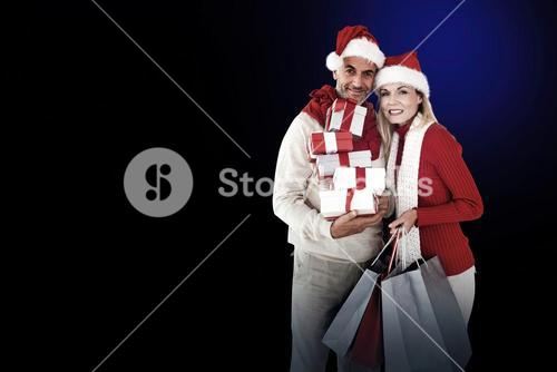 Happy festive couple with gifts and bags