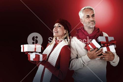 Happy festive couple with gifts