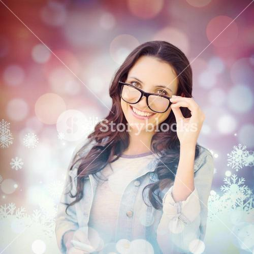 Composite image of brunette with smartphone