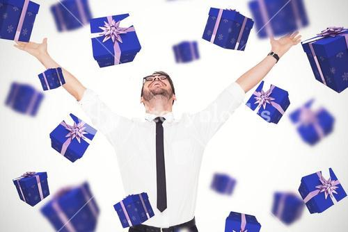 Composite image of cheering businessman with his arms raised up