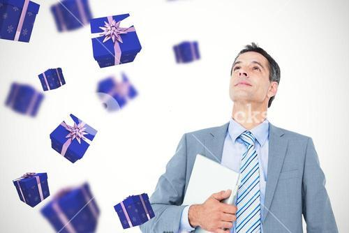 Composite image of excited cheering businessman holding his laptop
