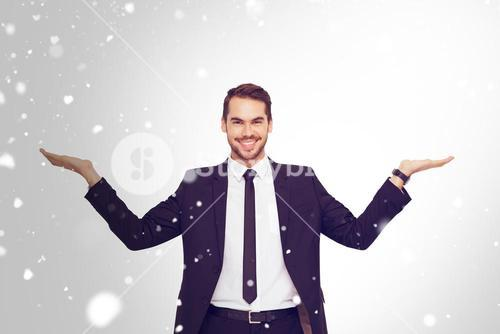 Composite image of businessman with open hands looking at the camera