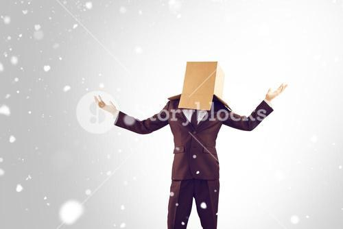 Composite image of anonymous businessman holding his hands out