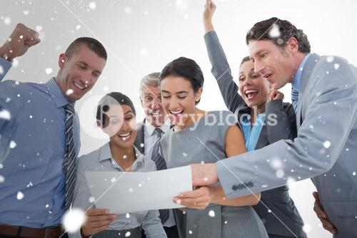 Composite image of business team celebrating a new contract