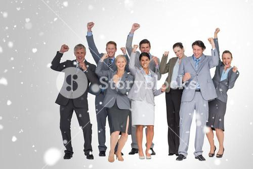 Composite image of excited business team cheering at camera
