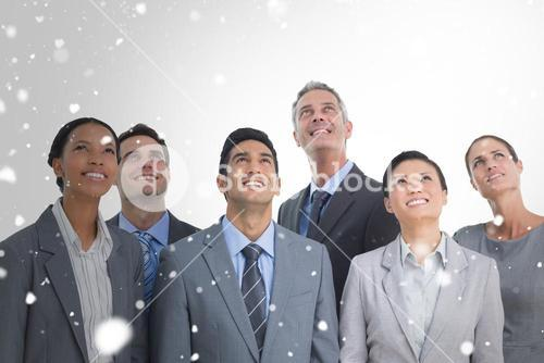 Composite image of business people looking up in office
