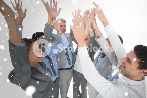 Composite image of business people raising their arms