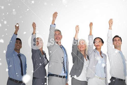 Composite image of smiling business people raising hands