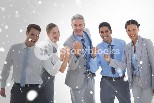 Composite image of portrait of successful business people clenching fists