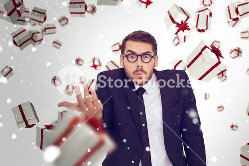 Composite image of doubtful businessman with glasses gesturing