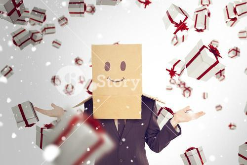 Composite image of businessman shrugging with box on head