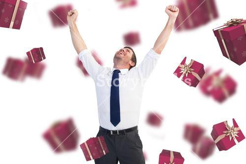 Composite image of cheering businessman
