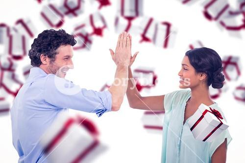 Composite image of business people high fiving over white background