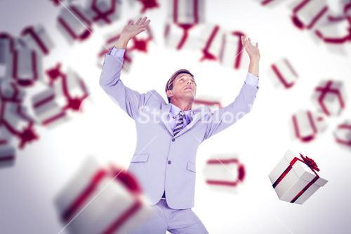 Composite image of scared businessman with hands raised