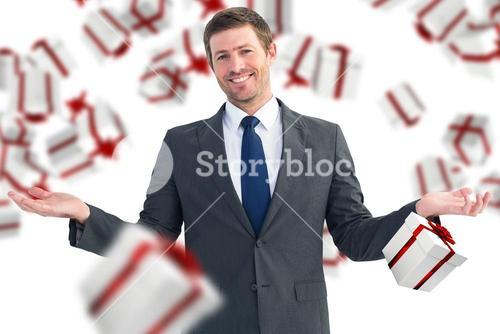 Composite image of happy businessman with hands out