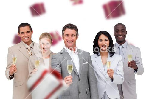 Composite image of business team celebrating a success with champagne