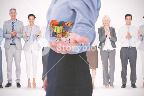 Composite image of businesswoman presenting with hand