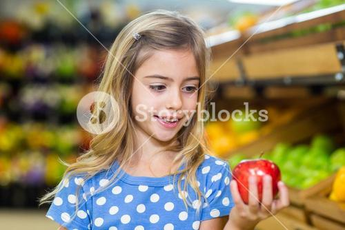 Cure girl holding an apple