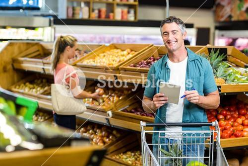 Smiling man holding the grocery list