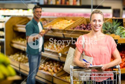 Smiling woman holding the grocery list
