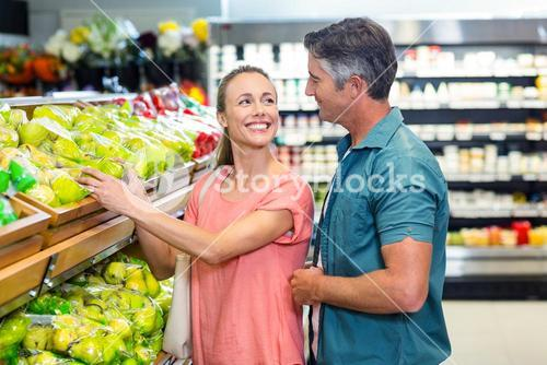 Happy couple at the supermarket