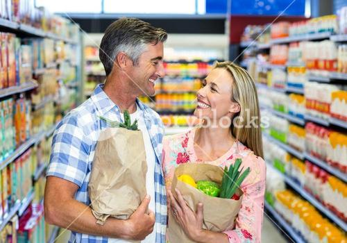 Smiling couple with grocery bags