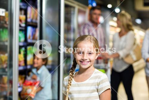 Smiling child with her family