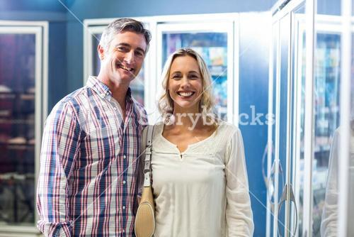 Smiling couple in supermarket